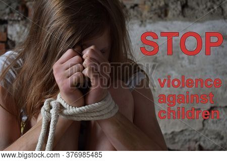 Young Girl With Tied Hands Kidnapped, Terrified, Hostage, Afraid. Stop Violence Against Children And