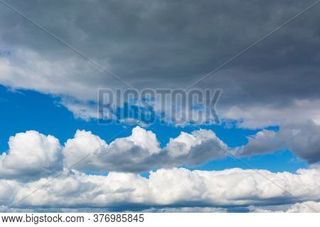 Gray Clouds On Blue Sky Background. Stormy Skies.
