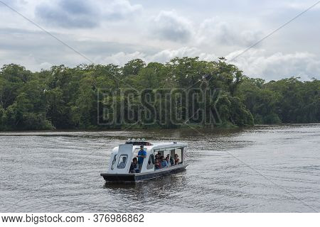 Tortuguero Village, Costa Rica-march 21, 2017: Tourist Boat With Unidentified People Visiting Tortug