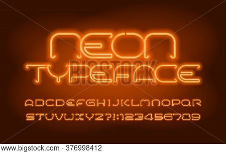 Neon Alphabet Font. Orange Neon Light Letters And Numbers. Blurred Background. Stock Vector Typescri