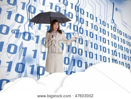 Businesswoman in front of printed circuit with binary code