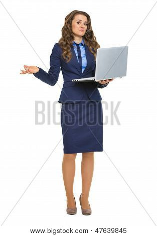 Full Length Portrait Of Clueless Business Woman With Laptop Shru
