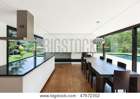 Modern villa, interior, beautiful dining room with kitchen island