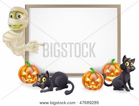 Halloween sign or banner with orange Halloween pumpkins and black witch's cats witch's broom stick and cartoon Egyptian mummy character poster