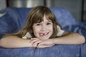 closeup portrait toothless cute smiling girl with long hair poster