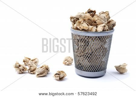 Iron Trash Bin Full Of Paper, Isolated On White Background