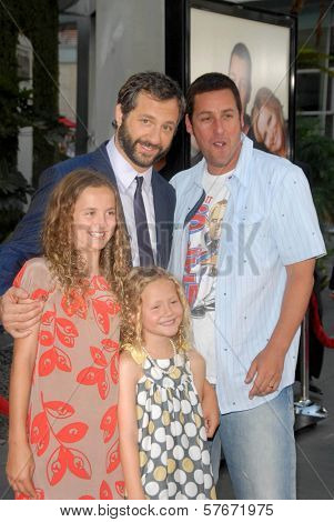 Judd Apatow and Adam Sandler with Maude Apatow and Iris Apatow at the World Premiere of 'Funny People'. Arclight Hollywood, Hollywood, CA. 07-20-09