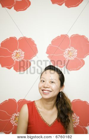 Young Woman By Red Poppy Background