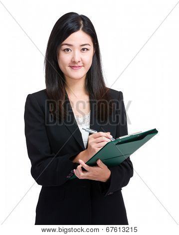 Business woman jot something on file pad
