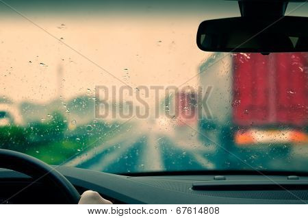 Bad weather driving on an expressway - Caution poster