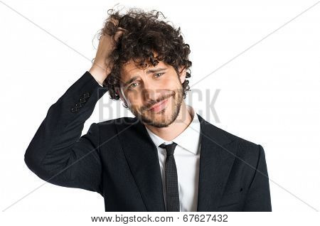 Portrait Of Handsome Uncertain Man Isolated On White Background