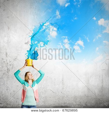 Young girl holding bucket with colorful splashes poster
