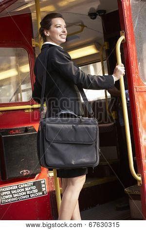 Businesswoman standing on Routemaster bus platform