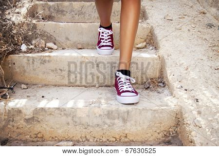 Barelegs With Red Sneakers Walking In Stairs