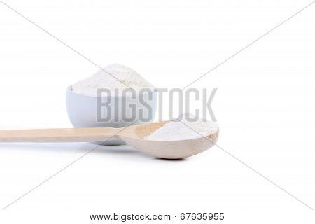 Spoon and bowl with flour.