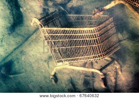 Abstract creative photo of shopping trolley discarded on the sea bottom. poster