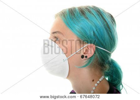 an attractive young woman wears a paper face mask to protect herself from the H1N1 Virus, or any unseen air born virus's or cooties.  isolated on white, with room for your text  health care