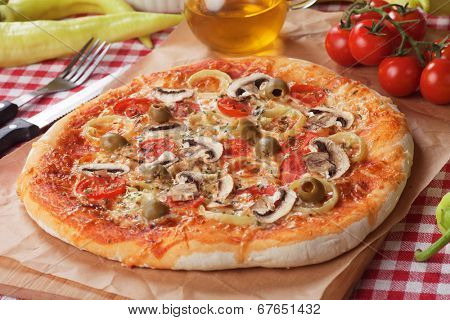 Italian funghi pizza with hot peppers, classic recipe with mushrooms, cheese and tomato