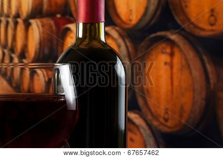 Wine Glass Near Bottle On Old Wine Cellar Background With Space For Text