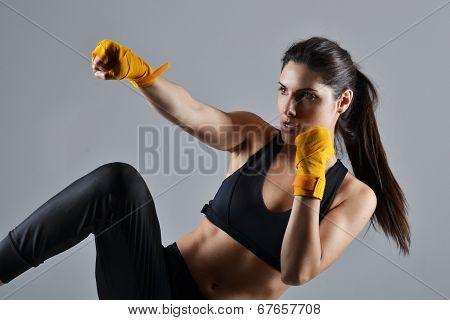 beautiful fitness woman with the yellow boxing bandage