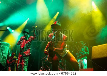 LOULE - JUNE 28: Jupiter and Okwess International a traditional music band from Rep. Dem. Congo performs on stage at festival med, a world music festival in Loule, Portugal, June 28, 2014