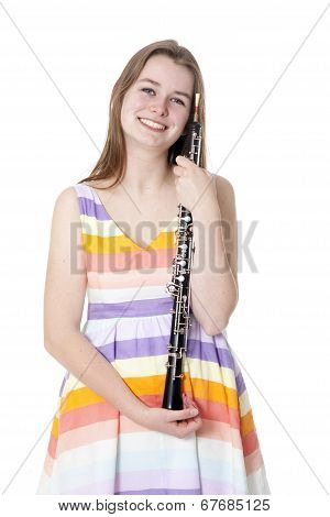 Smiling Girl In Colorful Dress With Oboe
