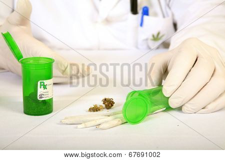 Medical Marijuana Buds, Shake and Joints aka Marijuana Cigarettes on display by a unidentifiable, Bored Certified Medical Marijuana Doctor.  Medical Marijuana is quickly becoming legal in the USA