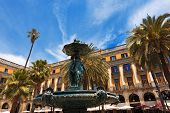 "Bronze fountain in Placa Reial (in Spanish Plaza Real) meaning ""Royal Plaza"" is a square in the Barri Gotic of Barcelona Catalonia Spain. It lies next to La Rambla poster"