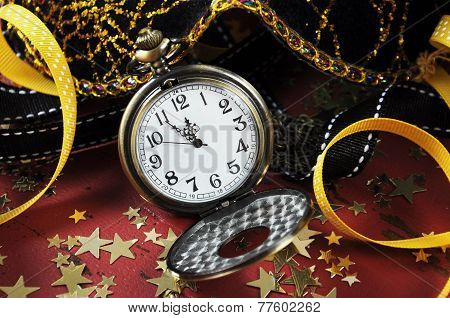 Happy New Year Pocket Fob Watch With Five To Midnight Time And Decorations On Red Rustic Distressed