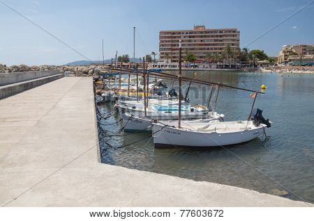 Llauts Moored In Cala Estancia Small Boat Marina, Majorca.