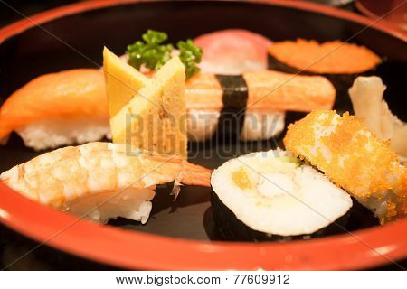 Closeup Sushi Set On Black Plate