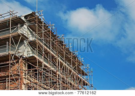 Scaffolding On Old Building Under Renovation