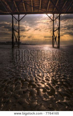 Bognor Regis pier early morning with sand detail, portrait orientation poster