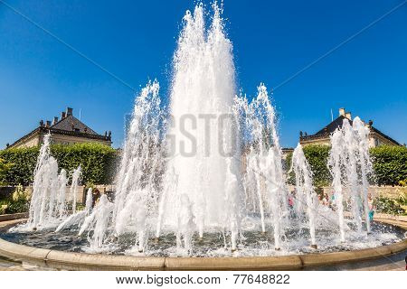 A fountain in the Amalie Garden and Amalienborg in Copenhagen Denmark poster