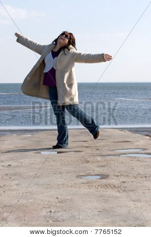 Woman Dancing At The Beach