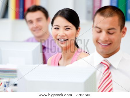 Happy Business People Working At A Computer
