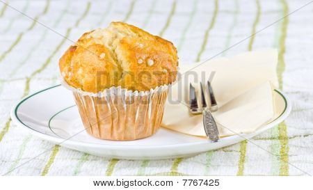 A Single Tasty Muffin Standing On A Cloth
