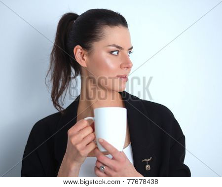 Woman holding a mug, isolated on white background