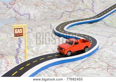Toy Car on Roadmap showing Petrol Station