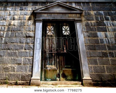 Old gothic door, bolded and chained closed