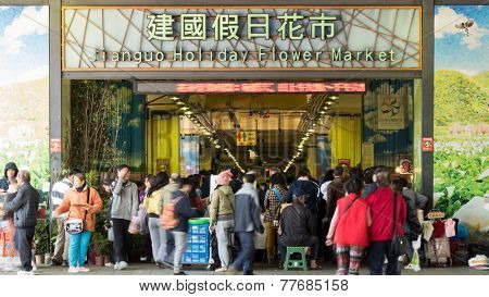 TAIPEI, TAIWAN - DECEMBER 6th : Famous Chien Kuo Holiday Flower Market in Taipei with many people, Taiwan on December 6th, 2014.