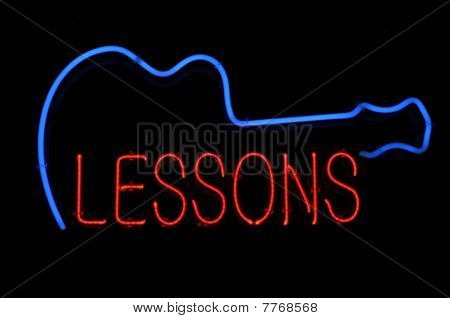 Guitar Lessons Neon Sign
