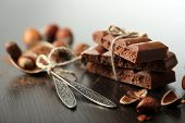 Tasty porous chocolate with nuts on table, close up poster