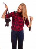 Attractive woman photographer holding two cameras and choosing between prodessional and compact photo camera - isolated on white poster
