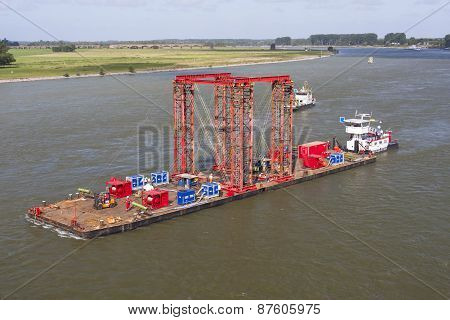 Industrial carrying platform pushed by a push boat on rhine river Germany. The platform is used as a swimming support for bridge deconstruction. poster