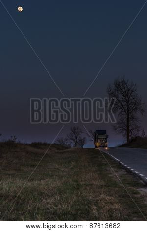 Truck On Road And Moon