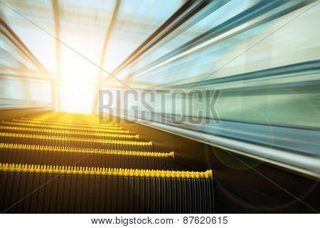 Blurry modern escalator at sunny day.