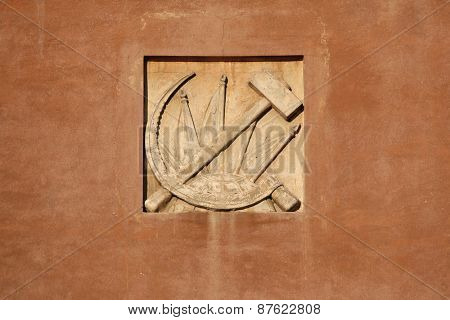Hammer and Sickle. Stucco decoration from the Soviet era on the building in Yekaterinburg, Russia.