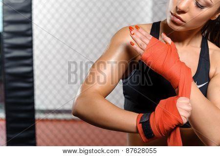 Female boxer does bandage