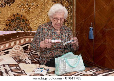 Senior Woman Takes Out Pills